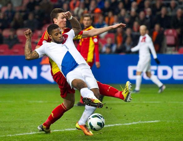 Lens of the Netherlands scores a goal past Gardos of Romania during their World Cup qualifying soccer match in Amsterdam