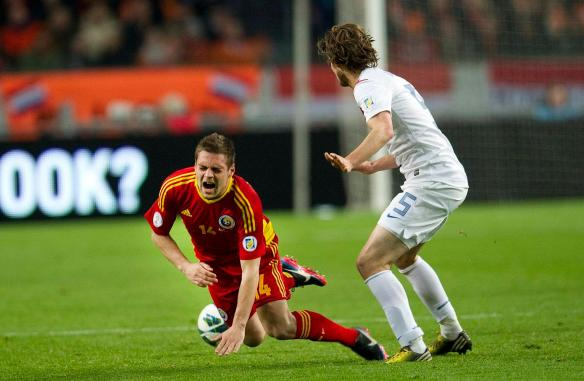 Blind of the Netherlands fights for the ball with Popa of Romania during their World Cup qualifying soccer match in Amsterdam