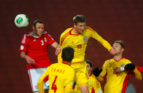 Vanczak of Hungary scores in front of Tamas, Goian and Radu of Romania during their 2014 World Cup Group D qualifying soccer match in Budapest
